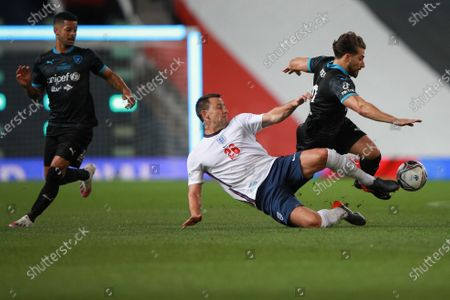 John Terry of England and Kem Cetinay of Soccer Aid World XI FC are pictured playing in Soccer Aid for Unicef 2020 at Old Trafford, Manchester.