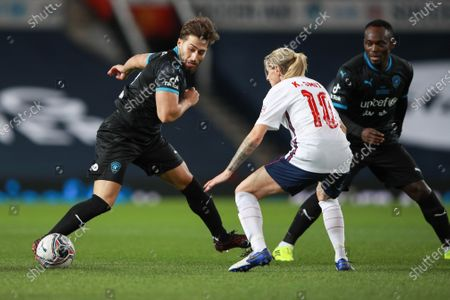 Kelly Smith of England and Kem Cetinay of Soccer Aid World XI FC are pictured playing in Soccer Aid for Unicef 2020 at Old Trafford, Manchester.