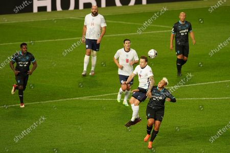 Danny Jones of England and Lianne Sanderson of Soccer Aid World XI FC battle for a header at Soccer Aid for Unicef 2020 at Old Trafford, Manchester.For further information, please contact Head of Communications Niall Malone niall@socceraidproductions.com© Unicef/SAP/(THOMPSON)20Photographed by Dave Thompson for Unicef UK and SAP LTD.06/09/2020