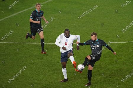 Emile Heskey of England and Iain Stirling of Soccer Aid World XI FC are pictured playing in Soccer Aid for Unicef 2020 at Old Trafford, Manchester.