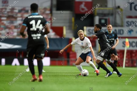 Katie Chapman of England and Patrice Evra of Soccer Aid World XI FC are pictured playing in Soccer Aid for Unicef 2020 at Old Trafford, ManchesterFor further information, please contact Head of Communications Niall Malone niall@socceraidproductions.com© Unicef/SAP/(HAMBURY)20Photographed by Daniel Hambury for Unicef UK and SAP LTD.06/09/2020