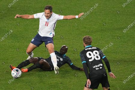 Joe Cole of England is tackled by Claude Makelele of Soccer Aid World XI FC in Soccer Aid for Unicef 2020 at Old Trafford, Manchester.