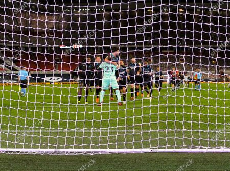 Ore Oduba (23) of Soccer Aid World XI FC is mobbed by his team mates as they celebrate their victory at the end of the Penalty Shoot Out in Soccer Aid for Unicef 2020 at Old Trafford, Manchester