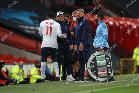 Emile Heskey is substituted by Wayne Rooney and Sam Allardyce of England during Soccer Aid for Unicef 2020 at Old Trafford, Manchester.