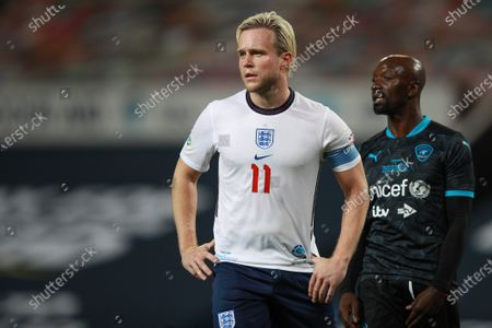 Olly Murs of England and Claude Makelele of Soccer Aid World XI FC are pictured playing in Soccer Aid for Unicef 2020 at Old Trafford, Manchester.