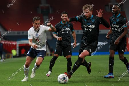 Joe Cole of England and Jeremy Lynch, Iain Stirling and Santan Dave of Soccer Aid World XI FC are pictured playing in Soccer Aid for Unicef 2020 at Old Trafford, Manchester.