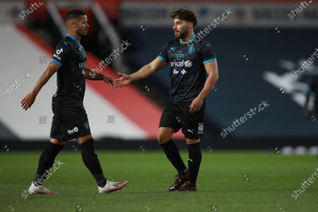 Jeremy Lynch and Kem Cetinay of Soccer Aid World XI FC are pictured tapping hands in Soccer Aid for Unicef 2020 at Old Trafford, Manchester.