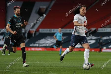 John Terry of England and Sergio Pizzorno of Soccer Aid World XI FC are pictured playing in Soccer Aid for Unicef 2020 at Old Trafford, Manchester.