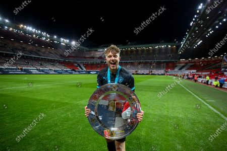 Roman Kemp of Soccer Aid World XI FC with the Soccer Aid for Unicef Shield after they defeated England on penalties in Soccer Aid for Unicef 2020 at Old Trafford, Manchester.