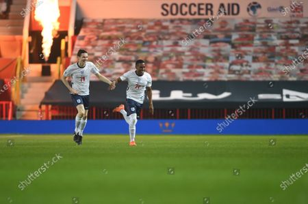 Yung Filly of England celebrates his goal against Soccer Aid World XI FC with the help of James Bay playing in Soccer Aid for Unicef 2020 at Old Trafford, ManchesterFor further information, please contact Head of Communications Niall Malone niall@socceraidproductions.com© Unicef/SAP/(HAMBURY)20Photographed by Daniel Hambury for Unicef UK and SAP LTD.06/09/2020