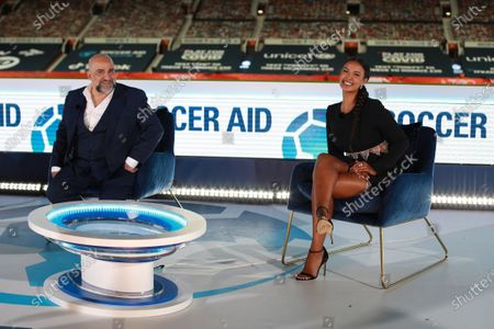 Omid Djalili [left] and Maya Jama [right] on the South Stand stage after Soccer Aid for Unicef 2020 at Old Trafford,