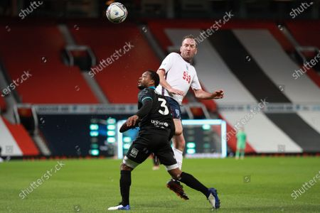 Lee Mack of England and Patrice Evra of Soccer Aid World XI FC are pictured playing in Soccer Aid for Unicef 2020 at Old Trafford,