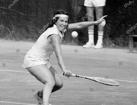 Rosemary Casals, of Sausalito, Calif. goes for the ball on her way to her second-round win in the U.S. Open tennis championships in the Forest Hills neighborhood of the Queens borough of New York. Casals and eight other women risked their tennis careers 50 years ago when they signed $1 contracts to launch a new women's circuit