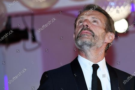 Lambert Wilson arrives for the 'Filming Italy Best Movie Award' ceremony during the 77th annual Venice International Film Festival, in Venice, Italy, 06 September 2020. The event is the first major in-person film fest to be held in the wake of the Covid-19 coronavirus pandemic. Attendees have to follow strict safety measures like mandatory face masks indoors, temperature scanners, and socially distanced screenings to reduce the risk of infection. The public is barred from the red carpet, and big stars are expected to be largely absent this year. The 77th edition of the festival runs from 02 to 12 September 2020.