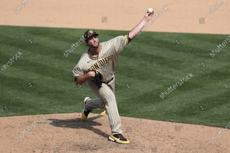 San Diego Padres' Drew Pomeranz throws against Oakland Athletics during the eighth inning of a baseball game in Oakland, Calif