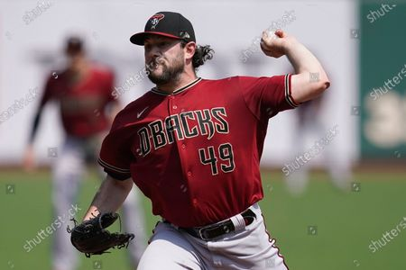 Arizona Diamondbacks' Alex Young (49) pitches against the San Francisco Giants during the first inning of a baseball game in San Francisco