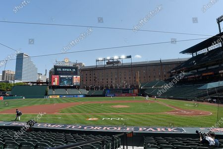 The scoreboard at Oriole Park at Camden Yard celebrates the 25th Anniversary of Cal Ripken Jr's consecutive game streak prior to the Baltimore Orioles and New York Yankees baseball game, in Baltimore, Md