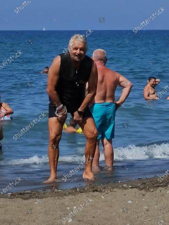 Beppe Grillo enjoys a holiday at the beach in Marina di Bibbona