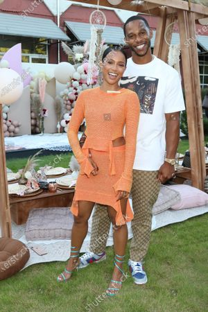 Karrueche Tran and Victor Cruz attend Teyana & Iman's babyshower in the courtyard at The Gathering Spot in Atlanta, Georgia