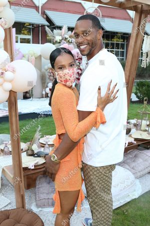 Stock Image of Karrueche Tran and Victor Cruz attend Teyana & Iman's babyshower in the courtyard at The Gathering Spot in Atlanta, Georgia