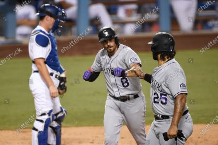 Colorado Rockies' Matt Kemp (25) congratulates Josh Fuentes (8) on his two-run home run as Los Angeles Dodgers catcher Will Smith looks on during the second inning of a baseball game in Los Angeles