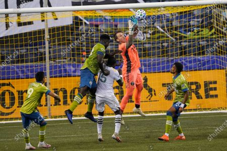 Portland Timbers goalkeeper Steve Clark, second from right, leaps to catch a shot during the second half of an MLS soccer match against the Seattle Sounders, in Seattle. The Timbers won 2-1