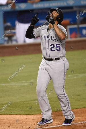 Colorado Rockies designated hitter Matt Kemp celebrates while approaching home plate on a two-run home run during the eighth inning of a baseball game against the Los Angeles Dodgers in Los Angeles