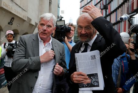 Editor-in-chief of WikiLeaks, Kristinn Hrafnsson from Iceland, left, and father of Julian Assange, John Shipton, speak to the media in London, . Lawyers for WikiLeaks founder Julian Assange and the U.S. government were squaring off in a London court on Monday at a high-stakes extradition case delayed by the coronavirus pandemic. American prosecutors have indicted the 49-year-old Australian on 18 espionage and computer misuse charges over the WikiLeaks publication of secret U.S. military documents a decade ago. The charges carry a maximum sentence of 175 years in prison