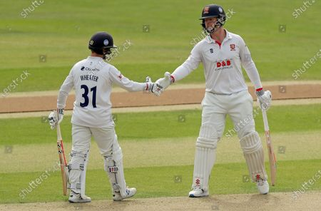 Stock Photo of Simon Harmer (right) of Essex congratulates Adam Wheater on scoring fifty runs during Essex CCC vs Middlesex CCC, Bob Willis Trophy Cricket at The Cloudfm County Ground on 7th September 2020