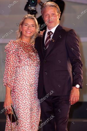 Actor Mads Mikkelsen, right, and Hanne Jacobsen pose for photographers upon arrival at the premiere of the film 'Miss Marx' during the 77th edition of the Venice Film Festival in Venice, Italy