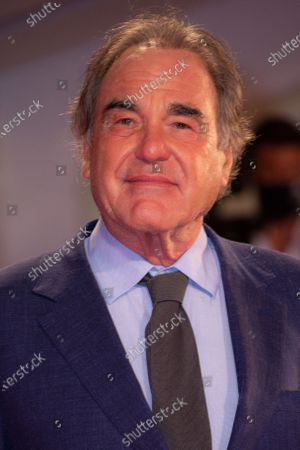 Oliver Stone poses for photographers upon arrival at the premiere of the film 'Miss Marx' during the 77th edition of the Venice Film Festival in Venice, Italy