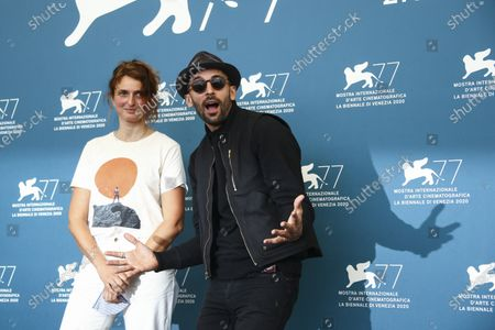 Directors JR, right, and Alice Rohrwacher pose for photographers at the photo call for the film 'Omelia Contadina (Paesant Homily)' during the 77th edition of the Venice Film Festival in Venice, Italy