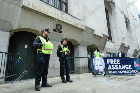 Police outside the entrance of the Old Bailey as Wikileaks founder Julian Assange's extradition hearing, which is expected to last for the next three or four weeks, resumes after it was postponed due to the coronavirus pandemic lockdown. Julian Assange is wanted in the US for allegedly conspiring with army intelligence analyst Chelsea Manning to expose military secrets in 2010.