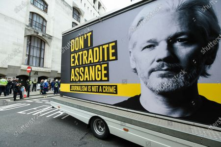 A van displaying an image of Wikileaks founder Julian Assange passes by at a protest outside the Old Bailey as his extradition hearing, which is expected to last for the next three or four weeks, resumes after it was postponed due to the coronavirus pandemic lockdown. Julian Assange is wanted in the US for allegedly conspiring with army intelligence analyst Chelsea Manning to expose military secrets in 2010.