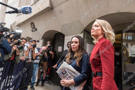 Julian Assange's lawyer, Jennifer Robinson (R) and fiancée, Stella Moris (2R), arrive at the Old Bailey as Julian Assange's extradition hearing, which is expected to last for the next three or four weeks, resumes after it was postponed due to the coronavirus pandemic lockdown. Julian Assange is wanted in the US for allegedly conspiring with army intelligence analyst Chelsea Manning to expose military secrets in 2010.
