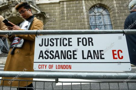 A sign erected by supporters of Wikileaks founder Julian Assange at a protest outside the Old Bailey as his extradition hearing, which is expected to last for the next three or four weeks, resumes after it was postponed due to the coronavirus pandemic lockdown. Julian Assange is wanted in the US for allegedly conspiring with army intelligence analyst Chelsea Manning to expose military secrets in 2010.