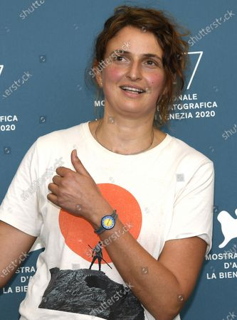 Alice Rohrwacher poses at a photocall for 'Omelia contadina' during the 77th annual Venice International Film Festival, in Venice, Italy, 07 September 2020. The movie is presented Out of Competition. The event is the first major in-person film fest to be held in the wake of the Covid-19 coronavirus pandemic. Attendees have to follow strict safety measures like mandatory face masks indoors, temperature scanners, and socially distanced screenings to reduce the risk of infection. The public is barred from the red carpet, and big stars are expected to be largely absent this year. The 77th edition of the festival runs from 02 to 12 September 2020.