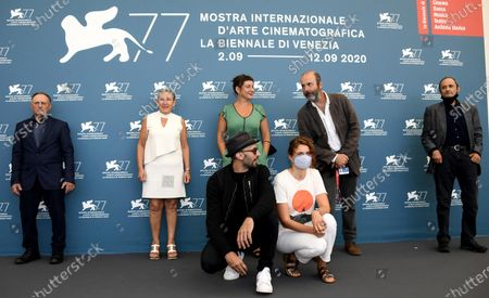 (Front) French filmmaker JR (L) and Italian filmmaker Alice Rohrwacher pose with all Italian actors (L-R back) Dario Sforza, Iris Pulvano, Elisa Cortese, Emanuele La Barbera and Luciano Bergaro at a photocall for 'Omelia contadina' during the 77th annual Venice International Film Festival, in Venice, Italy, 07 September 2020. The movie is presented Out of Competition. The event is the first major in-person film fest to be held in the wake of the Covid-19 coronavirus pandemic. Attendees have to follow strict safety measures like mandatory face masks indoors, temperature scanners, and socially distanced screenings to reduce the risk of infection. The public is barred from the red carpet, and big stars are expected to be largely absent this year. The 77th edition of the festival runs from 02 to 12 September 2020.