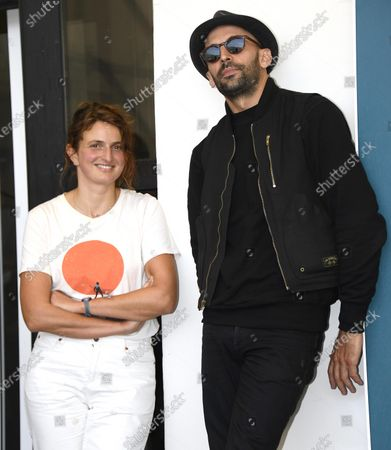French filmmaker JR (R) and Italian filmmaker Alice Rohrwacher pose at a photocall for 'Omelia contadina' during the 77th annual Venice International Film Festival, in Venice, Italy, 07 September 2020. The movie is presented Out of Competition. The event is the first major in-person film fest to be held in the wake of the Covid-19 coronavirus pandemic. Attendees have to follow strict safety measures like mandatory face masks indoors, temperature scanners, and socially distanced screenings to reduce the risk of infection. The public is barred from the red carpet, and big stars are expected to be largely absent this year. The 77th edition of the festival runs from 02 to 12 September 2020.