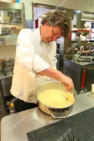 Chef Rowley Leigh prepares an ostrich egg in the kitchen at Le Cafe Anglais