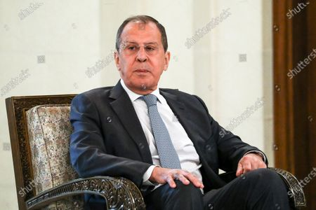 In this photo released by Russian Foreign Ministry Press Service, Russian Foreign Minister Sergey Lavrov listens to Syrian President Bashar al-Assad during their talks in Damascus, Syria, .Russia's foreign minister has met with Syrian President Bashar Assad shortly after landing in the Syrian capital on his first visit since 2012. Russia has been a close ally of Assad in Syria's long and bloody nine-year-long civil war, lending his government in Damascus vital military, economic and political support