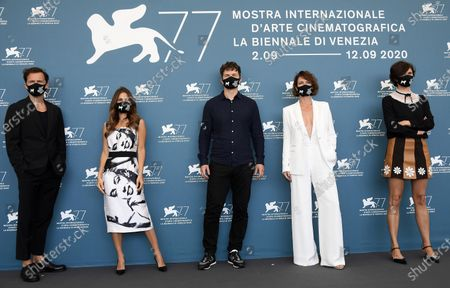 Polish co-filmmaker Michal Englert, Polish actress Weronika Rosati, Ukrainian-born English actor Alec Utgoff, Polish actress Maja Ostaszewska and Polish filmmaker Malgorzata Szumowska, with all wearing protective face masks, pose at a photocall for 'Sniegu juz nigdy nie bedzie (Never gonna snow again)' during the 77th annual Venice International Film Festival, in Venice, Italy, 07 September 2020. The event is the first major in-person film fest to be held in the wake of the Covid-19 coronavirus pandemic. Attendees have to follow strict safety measures like mandatory face masks indoors, temperature scanners, and socially distanced screenings to reduce the risk of infection. The public is barred from the red carpet, and big stars are expected to be largely absent this year. The 77th edition of the festival runs from 02 to 12 September 2020.