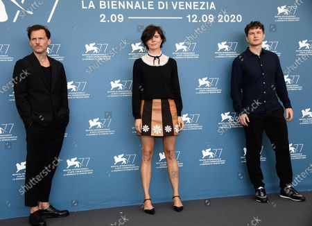 Polish co-filmmaker Michal Englert (L) and Ukrainian-born English actor Alec Utgoff (R) flank Polish filmmaker Malgorzata Szumowska (C) as they pose at a photocall for 'Sniegu juz nigdy nie bedzie (Never gonna snow again)' during the 77th annual Venice International Film Festival, in Venice, Italy, 07 September 2020. The event is the first major in-person film fest to be held in the wake of the Covid-19 coronavirus pandemic. Attendees have to follow strict safety measures like mandatory face masks indoors, temperature scanners, and socially distanced screenings to reduce the risk of infection. The public is barred from the red carpet, and big stars are expected to be largely absent this year. The 77th edition of the festival runs from 02 to 12 September 2020.