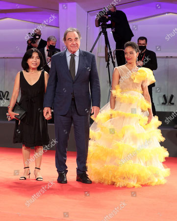 Oliver Stone, his wife Sun-jung Jung and guest
