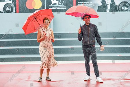 """Director Alice Rohrwacher and Artist JR walk the red carpet ahead of the movie """"Omelia Contadina"""" And """"Narciso Em Ferias"""" at the 77th Venice Film Festival on September 07, 2020 in Venice, Italy."""