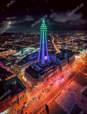 Stock Image of Blackpool Tower lit up on Friday night after the Blackpool illuminations were turned on. The lights were switched on by seven Corona Heroes, including a consultant, two nurses, a hospital catering manager, two extraordinary fundraisers, and a therapy dog and his owner.They were joined in a closed set in the Blackpool Tower Ballroom by the show hosts, Jordan & Perri, plus Ashley Banjo, Blackpool-born singer-songwriter Rae Morris, and the Illuminations creative curator Laurence Llewelyn-Bowen.