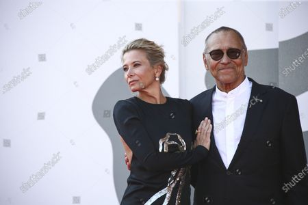 Actress Julia Vysotskaya, left, and director Andrei Konchalovsky pose for photographers upon arrival at the premiere of the film 'Dorogie Tovarischi (Dear Comrades)' during the 77th edition of the Venice Film Festival in Venice, Italy
