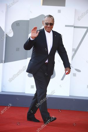Director Andrei Konchalovsky poses for photographers upon arrival at the premiere of the film 'Dorogie Tovarischi (Dear Comrades)' during the 77th edition of the Venice Film Festival in Venice, Italy