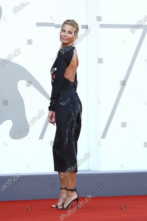 Actress Julia Vysotskaya poses for photographers upon arrival at the premiere of the film 'Dorogie Tovarischi (Dear Comrades)' during the 77th edition of the Venice Film Festival in Venice, Italy