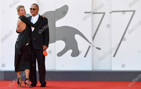 Andrei Konchalovsky (R) and his wife, Russian actress Julia Vysotskaya, arrive for the premiere of 'Dorogie Tovarischi! (Dear Comrades!)' during the 77th annual Venice International Film Festival, in Venice, Italy, 07 September 2020. The movie is presented in the official competition 'Venezia 77' at the festival running from 02 September to 12 September. The event is the first major in-person film fest to be held in the wake of the Covid-19 coronavirus pandemic. Attendees have to follow strict safety measures like mandatory face masks indoors, temperature scanners, and socially distanced screenings to reduce the risk of infection. The public is barred from the red carpet, and big stars are expected to be largely absent this year.